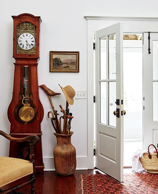 White walls with white trim makes an antique filled home feel more modern and up-to-date.
