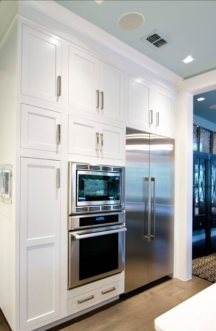 Beach house wall of white kitchen cabinets
