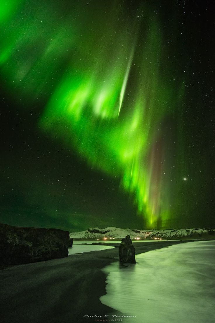 Iceland: Stars and the Aurora Borealis, photographer by Carlos F Turienzo.