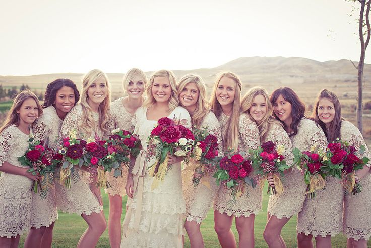 It's very different but I kind of like the idea of bridesmaids in a shade of cream. and i mean, the lace. beautiful dresses!