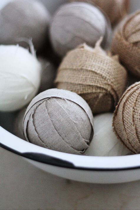 Burlap and Linen Rag Balls.  Not a tutorial, but a simple craft with burlap (or any fabric), styrofoam balls, and glue.  Love the primitive look, esp using an old enamelware bowl.... http://alicew.typepad.com/thoughts_from_alice_w/2010/03/been-creating.html