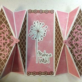 Today I wanted to try a new Fancy Fold card using BoBunny Primrose Collection and Spellbinders Die D-Lites Antique Corner die. Before we get started here is a list of the supplies that I used that are available on the Cut at Home website. Spellbinders Die D-Lites, Antique...