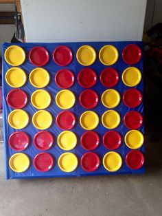 Life Size Connect Four--made for less than $10! Velcro, plates and tablecloth on a recycled furniture box! Perfect for family game night!