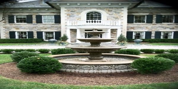 Small Home Exterior Ideas with Stone Exterior and Fountain
