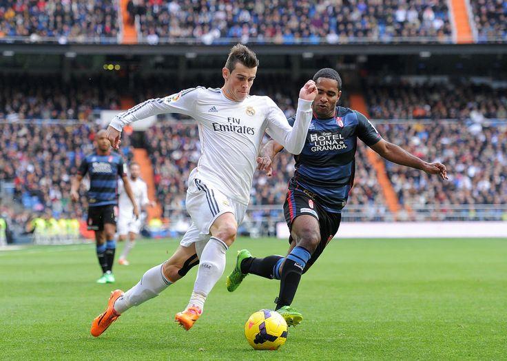 Gareth Bale tries to outrun Brayan Angulo of Granada CF during the La Liga match between Real Madrid CF and Granada CF at Santiago Bernabéu stadium on January 25, 2014 in Madrid, Spain.