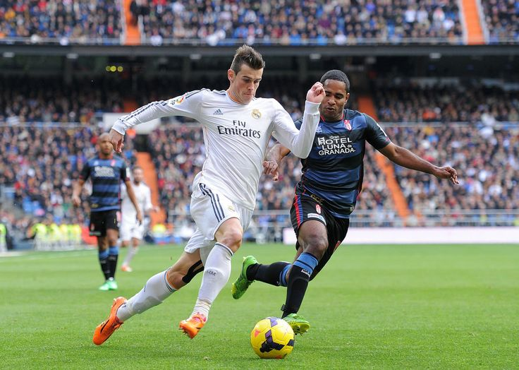 Gareth Bale tries to outrun Brayan Angulo of Granada CF during the La Liga match between Real Madrid CF and Granada CF at Santiago Bernabéu stadium on January 25, 2014 in Madrid, Spain.