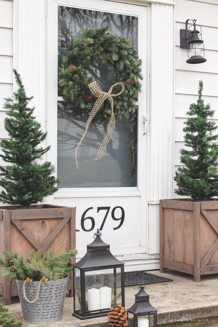 natural Christmas decor - love the wood planters with the tiny trees!