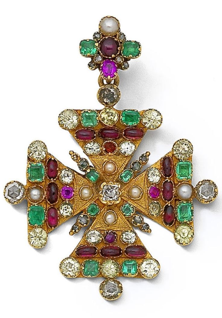 An antique multi-gem-set pendant circa 1840. Designed as a Maltese cross, set throughout with vari-cut gemstones including rose-cut diamonds, pearls, step-cut emeralds, oval cabochon garnets and cushion-shaped rubies, the reverse intricately engraved in a scrolling foliate design, to a similarly-set surmount, length 6.1cm. #antique #pendant