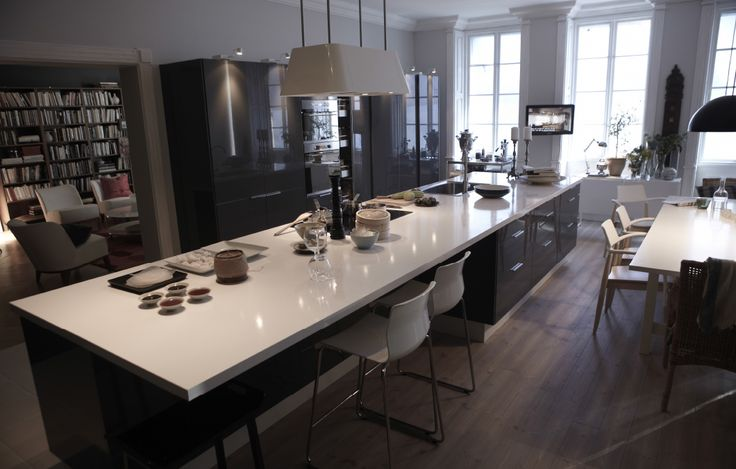 One of our favorite IKEA kitchens that combines a huge countertop with a sleek modern design in black and white.