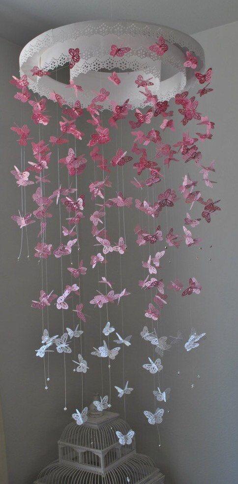Papel encaje araña mariposa monarca móvil rosa por DragonOnTheFly