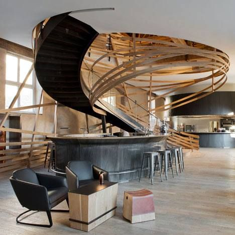 a spiral of wooden strips surrounds a staircase in the restaurant of this strasbourg hotel. Black Bedroom Furniture Sets. Home Design Ideas