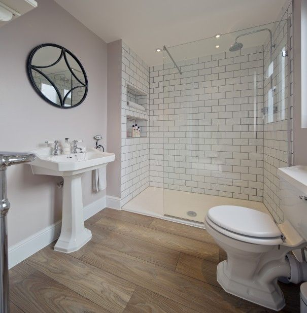 light purple bathroom walls white subway tile shower wood floors pretty romantic