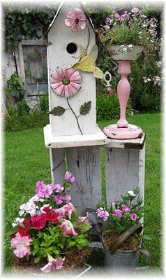 Love the garden birdhouse and the pink stand next to it.  the pinks and whites brighten up a garden scene