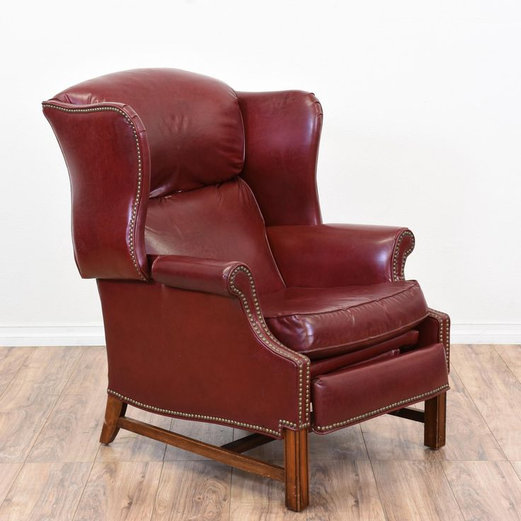 """This """"Barcalounger"""" recliner is upholstered in a durable deep red pleather vinyl upholstery. This armchair is in great condition with a tall reclining wingback, lift up footrest and nailhead trim. Comfortable and luxurious chair perfect for lounging! #traditional #chairs #recliner #sandiegovintage #vintagefurniture"""