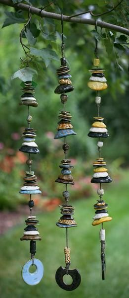 This dramatic strand of individually crafted pottery discs fired in earthy glazes is a very striking piece of art.  This unique mobile brings a real artisan's t