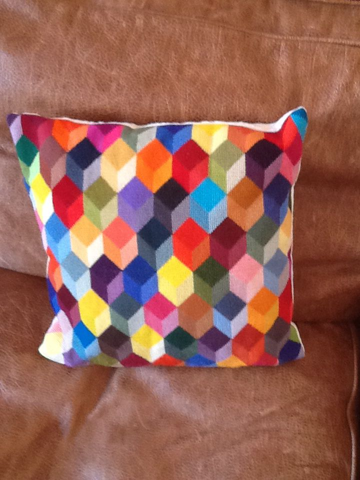 Tumbling blocks designed and completed by me, made into a cushion.