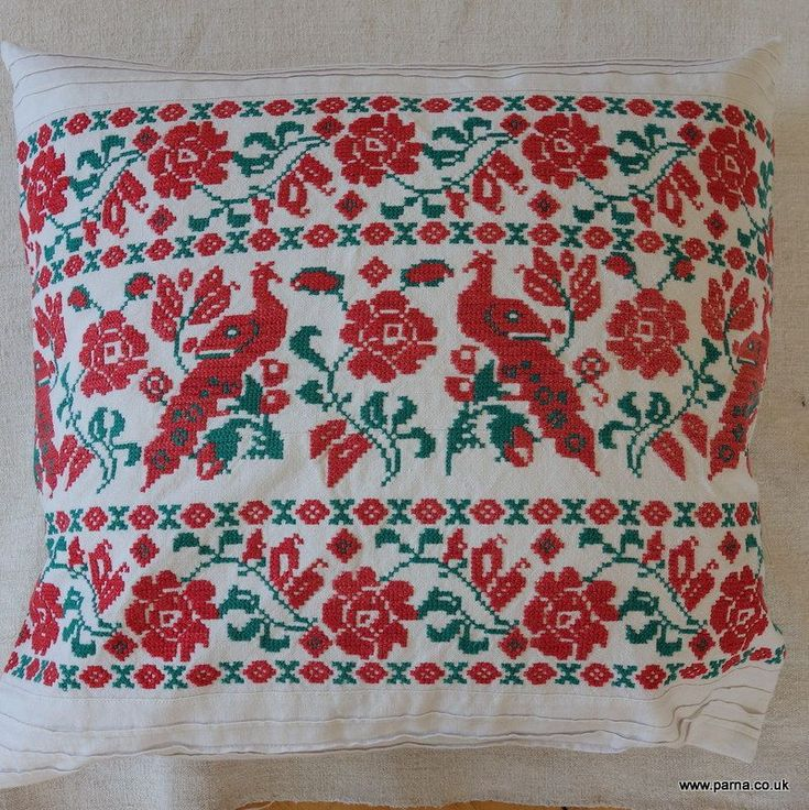 A pair of cushion coves from antique Transylvanian cross stitch embroidery originating from a small village in the Kalotaszeg region of Transylvania