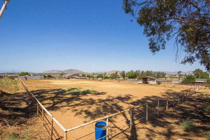 Horse Property for Sale in Riverside County in California. This is the perfect property for your horses, RV's, toys and more. Located on approximately 5 acres includes adjacent parcel 454-030-024 with a single story home, multiple large sheds, horse arena plus the backyard of the home is fenced! A whole house fan keeps the interior cool on warm days.
