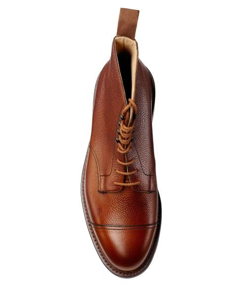 $725 CROCKETT AND JONES CONISTON BOOT IN TAN - SOLD by TODD SNYDER New York - Affiliate - Made in England Derby Boot scotch grain leather, Dainite rubber soles and a storm welt. The perfectall weatherboot, storm welt is designedto keep water from getting into the footwear and soaking the sole. UK sized, please size down for correct fit (i.e. if you're a US 10, purchase a UK 9.5).Storm Welt Daninte rubber sole Grained leather Made in England