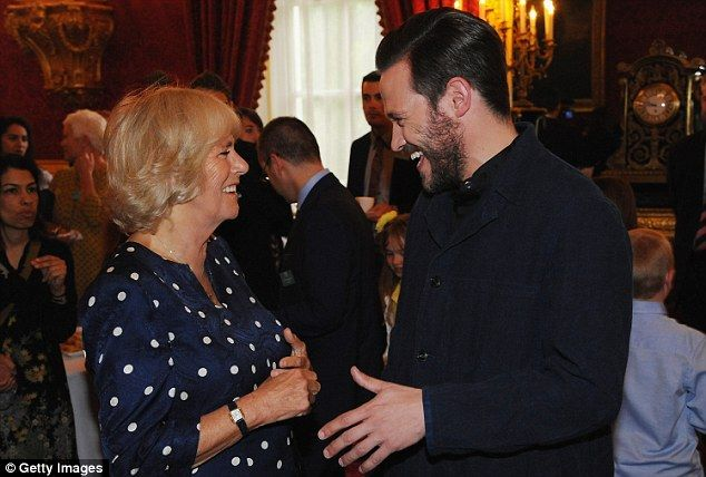 The Duchess of Cornwall and Pop Idol winner Will Young share a joke at the event...