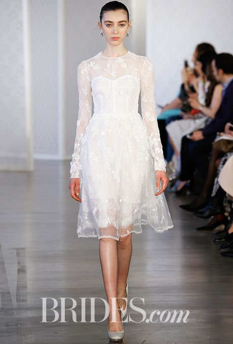 Brides.com: . Layered lace and floral embroidered cocktail wedding dress with crepe de chine lining, Oscar de la Renta