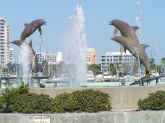 View of the Dolphin fountain and the beginning of Sister Cities Walk at Bayfront Park as seen from the Deep Six Lounge and Piano Bar at Marina Jack's, downtown on Sarasota Bay