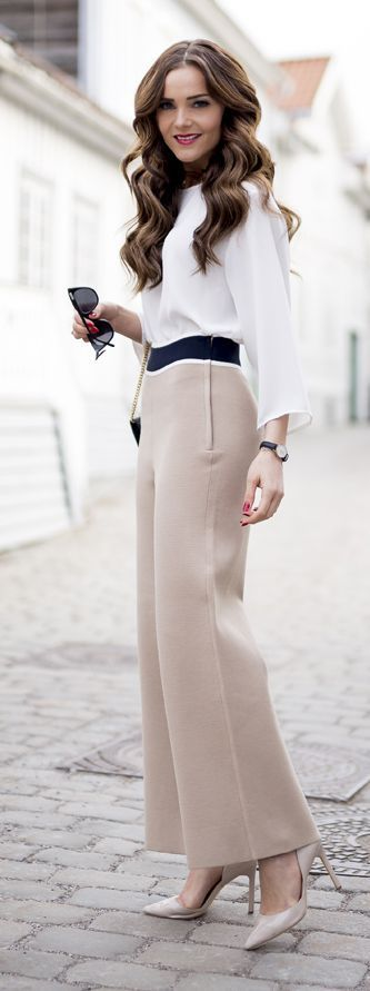 Nude wide leg pants and a white blouse for a classy work look.