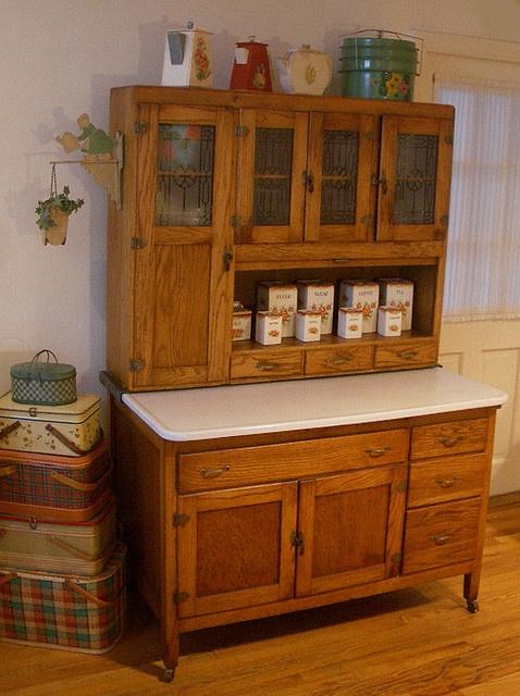 old hoosier cabinet note wheels and bracket under long door it allows the enameled metal. Black Bedroom Furniture Sets. Home Design Ideas