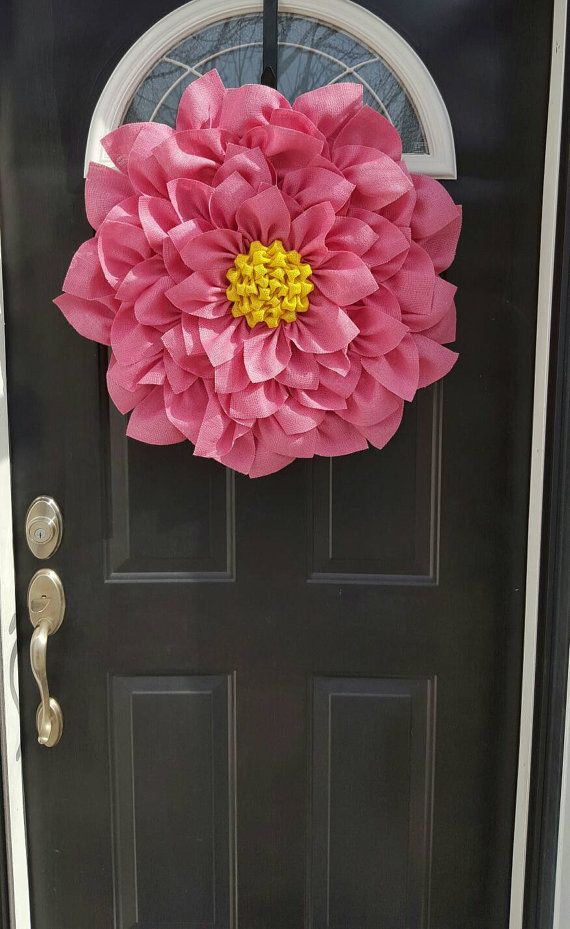 This pink and yellow Burlap Flower Wreath measures between 27 and 28 inches. It is made with Jute burlap. And edges are sealed to help prevent