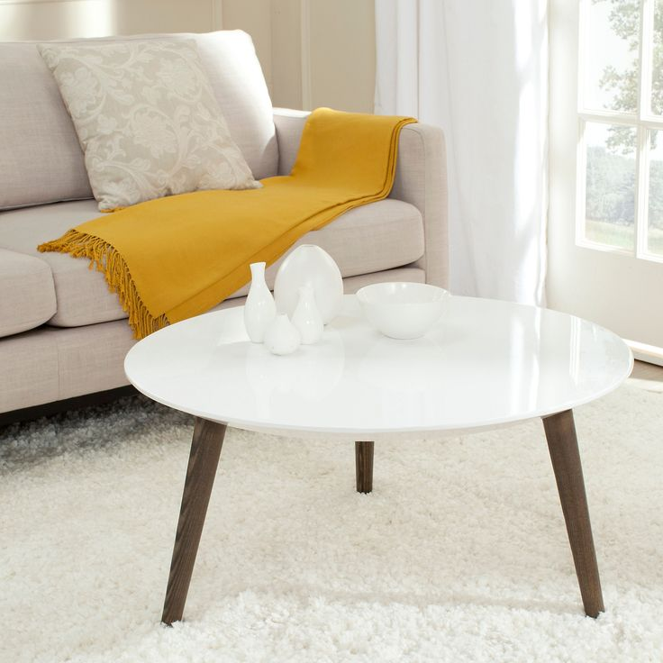 Rugged meets refined on this contemporary coffee table. Features a white lacquer top and chunky wood grained legs in a dark brown finish. Whether set in a study or a living room, this dramatic...