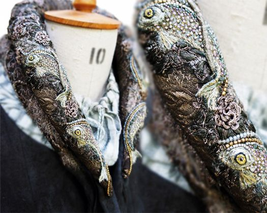 House Tully, represented by gorgeously embroidered fish, on one of the many collars Catelyn is seen wearing throughout the series.