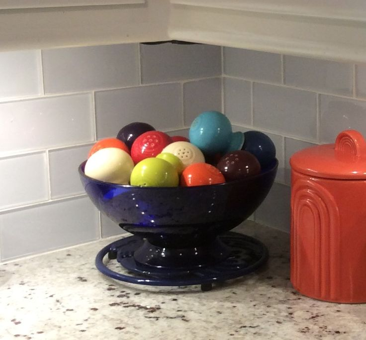 A bowl of Fiesta® Salt & Pepper Shakers.