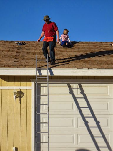 Mr Young and his daughter mapping out the family home roof for a solar kit. Take your own family solar with a DIY Solar kit from www.ThatSolarGuy.com