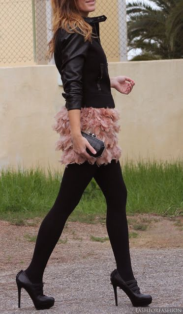 Pink feather skirt and leather jacket