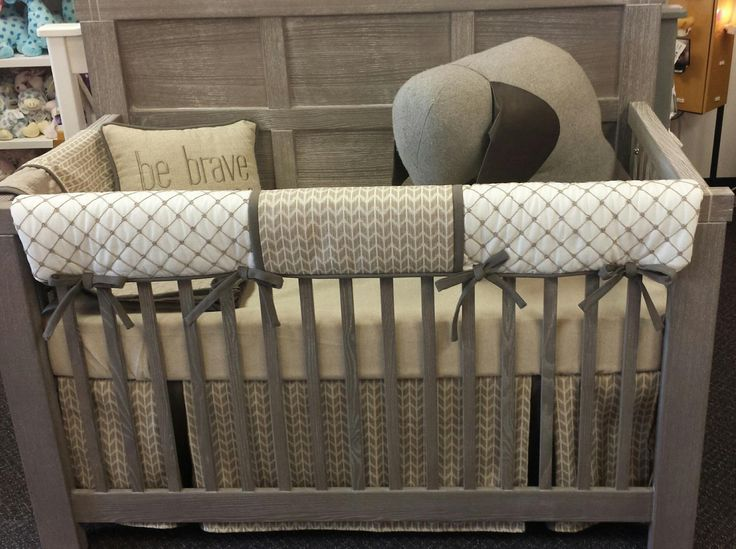 Tan Arrow crib bedding set called Nottingham by Pine Creek Bedding on display at Wizard of Kids in Fargo, ND on a Natart crib with a rustic finish