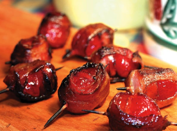 SMOKIN' CHERRY BOMBS - These bacon-wrapped, whiskey-soaked, maraschino cherries and smoked hot Italian sausage explode with flavor and grilling makes them a great tasting barbecue appetizer. Soaking the cherries in a bourbon for a good week gives them the perfect flavor punch. The cooking process dissipates the alcohol, but the flavor stays and fuses perfectly with the cherries, bacon, and smoky sausage.