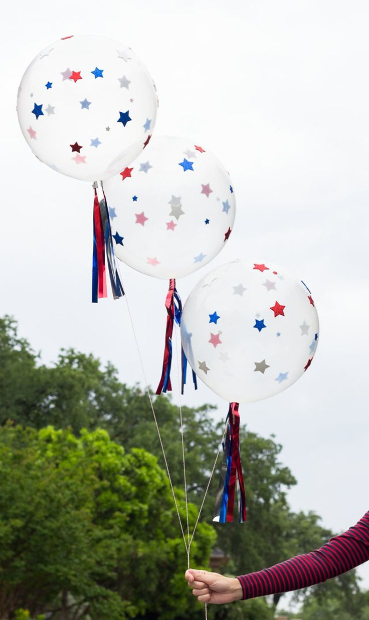 Star-spangle some clear balloons with stick-on shapes and store-bought metallic fringe. To make hers, Haeley of Design Improvised used a helium tank to blow up the balloons, but you can also ask a local party store to inflate them and then jazz them up at home.