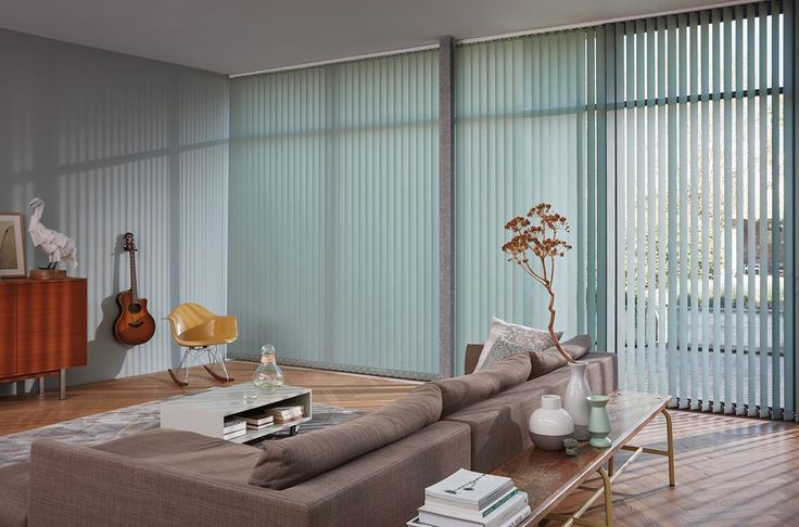 "A bold, new trend in vertical window treatments. New and exclusive to Luxaflex® are the Vertical Blind Panels. The ""Pure & Natural"" collection is a fresh new look built on contemporary designs.  Our Vertical Blinds feature ""Child Safe systems(Child Safe systems)"":#personalize including motorised systems, chain tensioner and cord cleat."