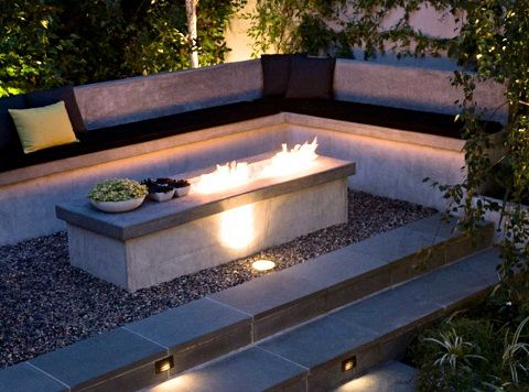 fire pit ideas Pasadena, Calif., landscape design firm Lenkin Design efficiently incorporates seating that extends to a simple, but modern, custom fire element. Photo courtesy of Heather Lenkin.