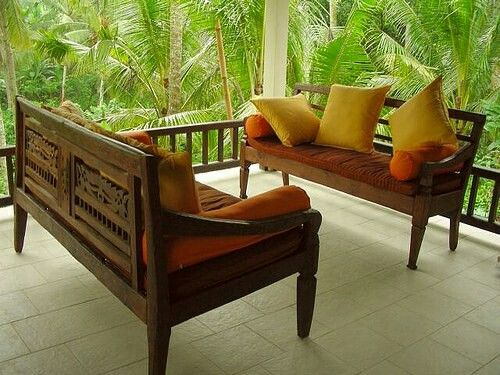 A pleasent out door seating of teak wood..