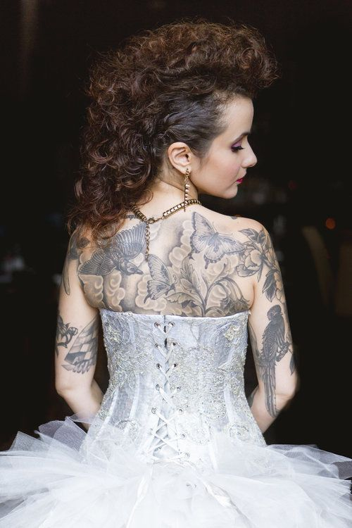 Back laceup detail of Galit Levi from Designer Loft wedding gown on tattooed bride with faux hawk hair at Punk Rock inspired wedding // Photo by Amy Sims Photography