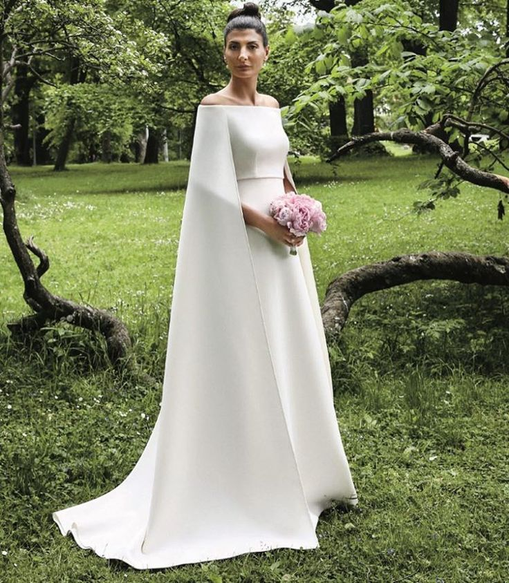 @bat_gio wore a custom made off the shoulder caped #hautecouture gown for her private civil ceremony in Stockholm before the festivities in Capri. Maison Valentino