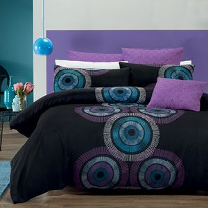An eye-catching, large circular print is the feature of this striking design that showcases a colour contrast of blues, light purple and white on a black background. The quilt cover set features a small, blue circular print reverse and the overall design is enhanced by a beautifully embroidered and quilted euro pillowcase and cushion cover in a co-ordinating light purple. The quilt cover has press stud closure.