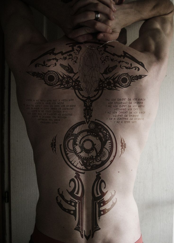 Tattoo final fantasy with the story summoning Bahamut and the end of the life. The Grey Jedi code inclue in aurebesh. Mounting with Photoshop. false tatoo in my skin.