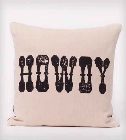 Howdy Organic Cotton Pillow | A swaggering greeting graces the front of this organic cotton pillow