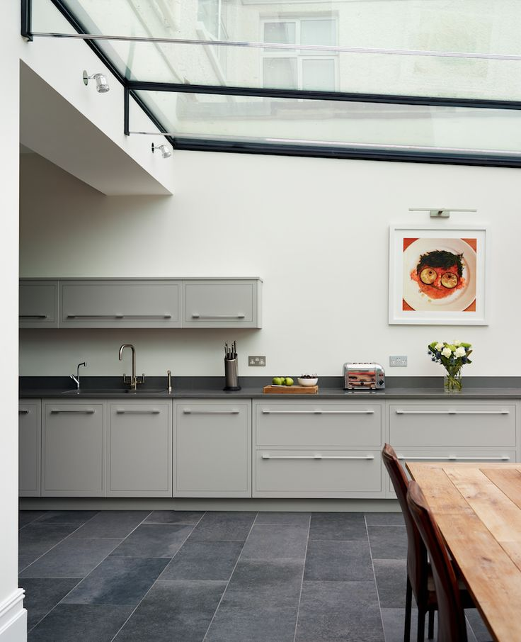 Harvey Jones Linear kitchen painted in Zoffany 'Silver'. #kitchendesign #bespokekitchens