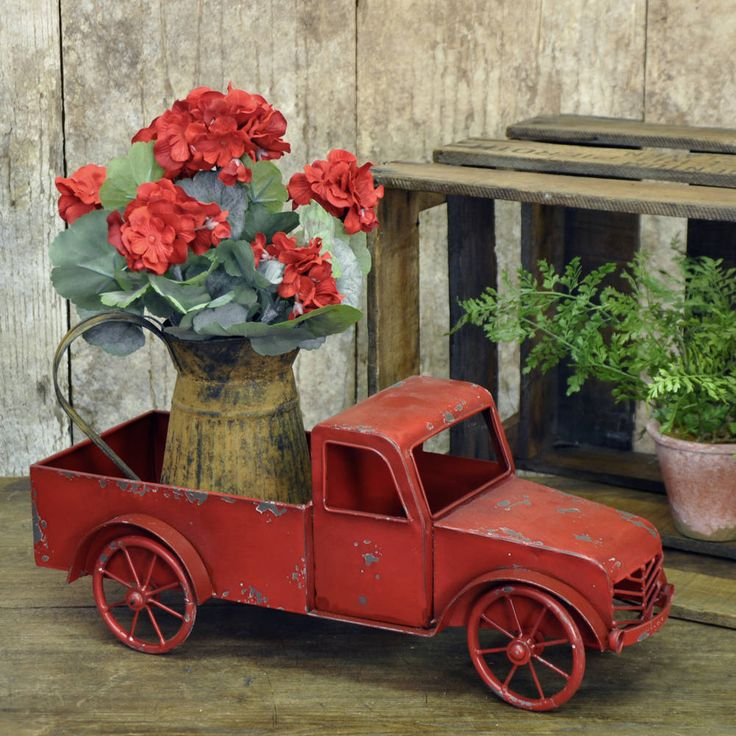 """Vintage style metal pick-up truck Red distressed finish Functioning wheels Measurements Truck: 7.5""""H X 19""""L X 8.5""""W; Truck Bed: 9 1/2""""L x 6 3/4""""W For Decorative Use Only Not Intended for Children The red pick-up truck is one of the quintessential symbols of the American spirit. Once you would have seen this classic truck rumbling down a country lane or hard at work on a farm. Now you can bring this piece of vintage Americana into your home, porch or garden to be used as a planter or as a…"""