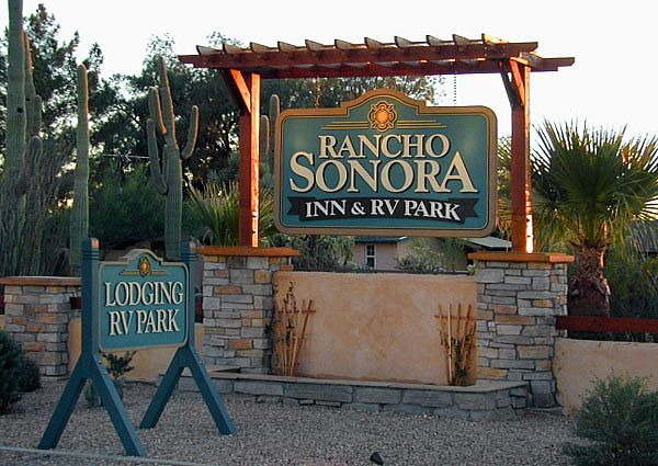 """Business Signs Outdoor business signs forRancho Sonora Inn & RV Parklocated in Arizona included many signs of various shapes and sizes. The main hanging sign was installed in a stone and cedar timber construction along the main roadway leading into the resort. The outdoor portable sign included the 4"""" X4"""" cedar support system. The project also included eight employee parking signs, three office wall mounted signs, and four directional signs guiding guests to resort facilities."""