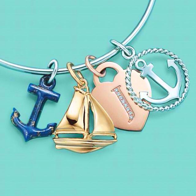 Tiffany and Co nautical charms. Sailboat!! (I see anchors everywhere, but never sailboats!) love