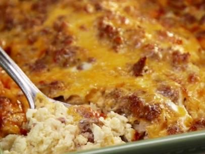 Paula Deen Breakfast Casserole--easy & delish! Paired it with fruit and pumpkin bread for Thanksgiving morning. Used what I had on hand--bacon & added 1 tsp. smoked paprika. I'll make this again--I'll add New Mexico Hatch green chile to give it some kick.